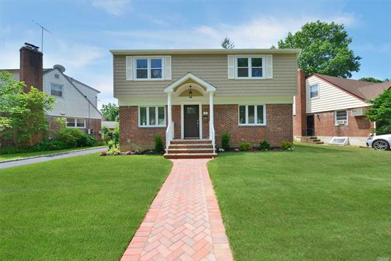 Huge Colonial .Newly Renovated In The Heart Of New Hyde Park.Meticulously cared for .5 Bedrooms, 3 Full Baths Eat in Kitchen.New Appliances, wool floods, Full Finished Basement, 1 Car Garage , Central Heating and Cooling .Plus So Much More.