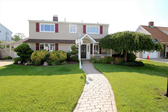 This Is The One You've Been Waiting For! Beautiful Colonial With Great Curb Appeal On A Quiet Street! Features Include Brick Walk, Front Porch, Brand New EIK W/Dual Fireplace To FDR, Lr, Lg Fam Rm W/Built-Ins & Elec Fpl. Slider Leads To Deck W/Pergola & Prof Landscaped Yard. Fb & Laundry/Pantry Completes The 1st Floor. Master Bedroom With Wall Of Closets, 3 Additional Bedrooms & Updated Fb On 2nd Floor. Recent 30 Yr. Roof, Siding, Updtd Windows, Electric, Heat System In Garage.