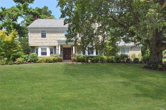 Move Right Into This Traditional CH Colonial on Beautiful St in Woodsburgh. 5 BR, 3.5 Bth, . Lr/Fpl, FDR, Updtd Gran/Wood Kosher EIK with Radiant Htd Flrs & Stainless Steel Appliances, Family Rm & Billiards Rm. Full Finished Dry Bsmt with High Ceiling.No Sandy Damage. Crown Moldings & HW Flrs Throughout. Parklike 1/2 Acre Property with Brick Patio. CAC, IG Sprinklers, Alarm. Roof 8 Yrs. 2 Car Att Garage. SD#14. MUST SEE!!