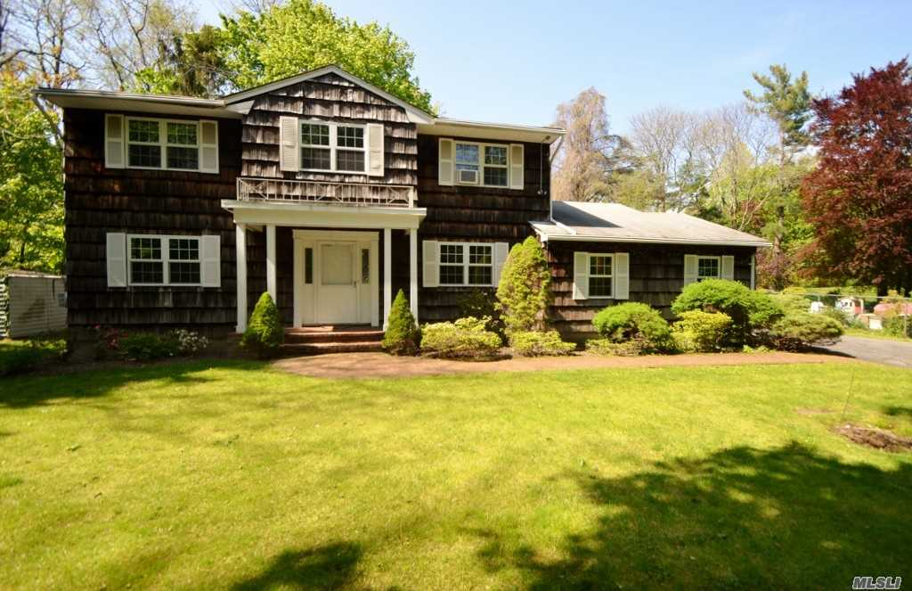 Classic Center Hall Colonial! Large Ef, Formal Lr, Fdr, Eik w/Mud Rm/W/D, Powder Rm, Den w/Wood Burning Fireplace and French Doors to Patio. 2nd Floor; Master Bdrm Suite w/Full Bath, 3 Addl Bdrms & Hall Full Bath. 2 Car Attached Garage. Wonderful Yard and Property. Award Winning North Shore Schools!