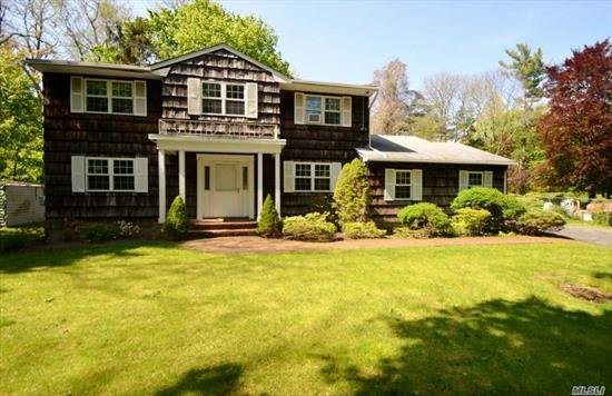 Classic Center Hall Colonial Nestled on Private Setting! Large Ef, Formal Lr, Fdr, Eik w/Mud Rm/W/D, Powder Rm, Den w/Wood Burning Custom Fireplace and French Doors to Stone Patio, Hardwood Floors Throughout. 2nd Floor; Master Bdrm Suite w/Full Bath, 3 Addl Bdrms & Hall Full Bath. 2 Car Attached Garage. 6 Car Driveway. In-ground Sprinklers. Wonderful Yard and Property. Award Winning North Shore Schools!