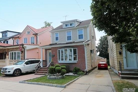 Renovated colonial with updated baths and kitchen. 4 bedrooms 2.5 baths. Stucco and brick exterior with siding. Full finished basement with full bath. New roof and siding and pavers. Close to parkways, LIRR and shopping. 1st floor is being used as a daycare but will be converted before closing.
