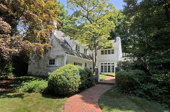 Classic architect designed English country house. Private 1/2 acre, w lovely landscaped property and front porch overlooking courtyard. Separate artist studio/office w 1/2 bath & fp. Custom features throughout w 4 fireplaces, beautiful window vistas, built-in shelving, window seats, cathedral ceilings and more. Beacon Hill Association beach on Hempstead Harbor w $175 dues.