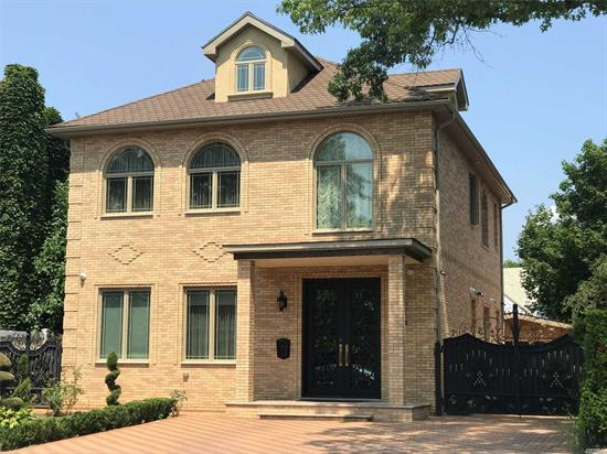 New stunningly designed and decorated, brick detached 5 BR, 4.5 Baths on 50x100 Lot. Large and sunny rooms with high 10 ' ceiling , spacious LR, DR, and bedroom with full bath on first floor. Dramatic staircase, baronial sized master bedroom, Kitchen of tomorrow opulent baths, Finished basement , Garage, PS 196 , just steps to shopping and transportation