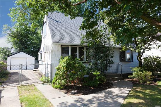 Cape Cod on Dead End Block with new roof, new Gutters and Leaders. New Hot Water heater. New Carpet in the upstairs bedrooms. Re-done hardwood floors on the first floor. Granite floor tiles and skylight in the eat in kitchen.Skylight in the bathroom.Fenced in backyard.