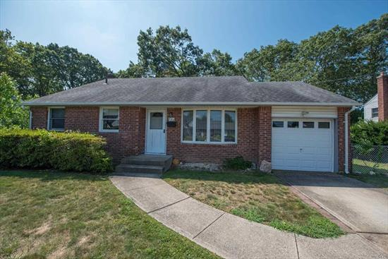 Well Maintained 3 BR Split with lots of potential. Hardwood floors, newer roof, windows and siding. Large fenced yard.