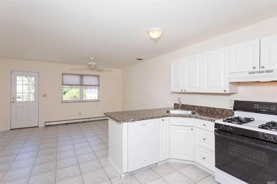 This sunlit unit offers a large eat in kitchen with doors to a balcony for outdoor spaace. Each bedroom has a bathroom and the lower level offers washer/dryer hook up and storage as well as access to the garage. Close to transportation, shopping and dining.