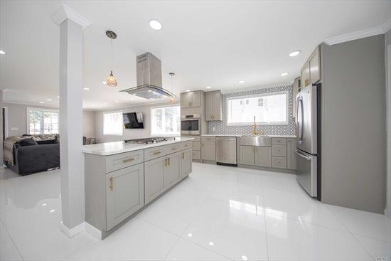 Gorgeous Pinterest inspired renovation. House was completely gutted and redone with ultra high end finishes top to bottom. Double door grand entrance, open concept, chef's kitchen w/ top of the line quartz counters, GE's best appliances, 3 1/2 five star baths, huge great room w/ lots of natural light. New roof, boiler, HW heater, CAC, stoop & handrail. Very private block with rare front and rear entry. Huge driveway & garage. Fully finished basement. 165 LED High Hats. Taxes grieved.
