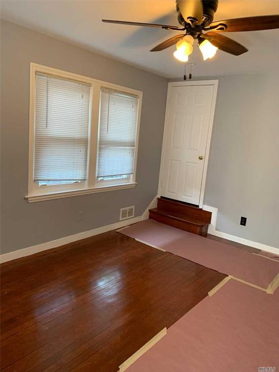 This is a fully renovated nice and clean property in a desire able neighborhood of Elmont, featuring 4 Bedrooms, two full bath rooms, hardwood floors, new paint, laundry, and a deck in the back,  possible mother daughter with proper permit.