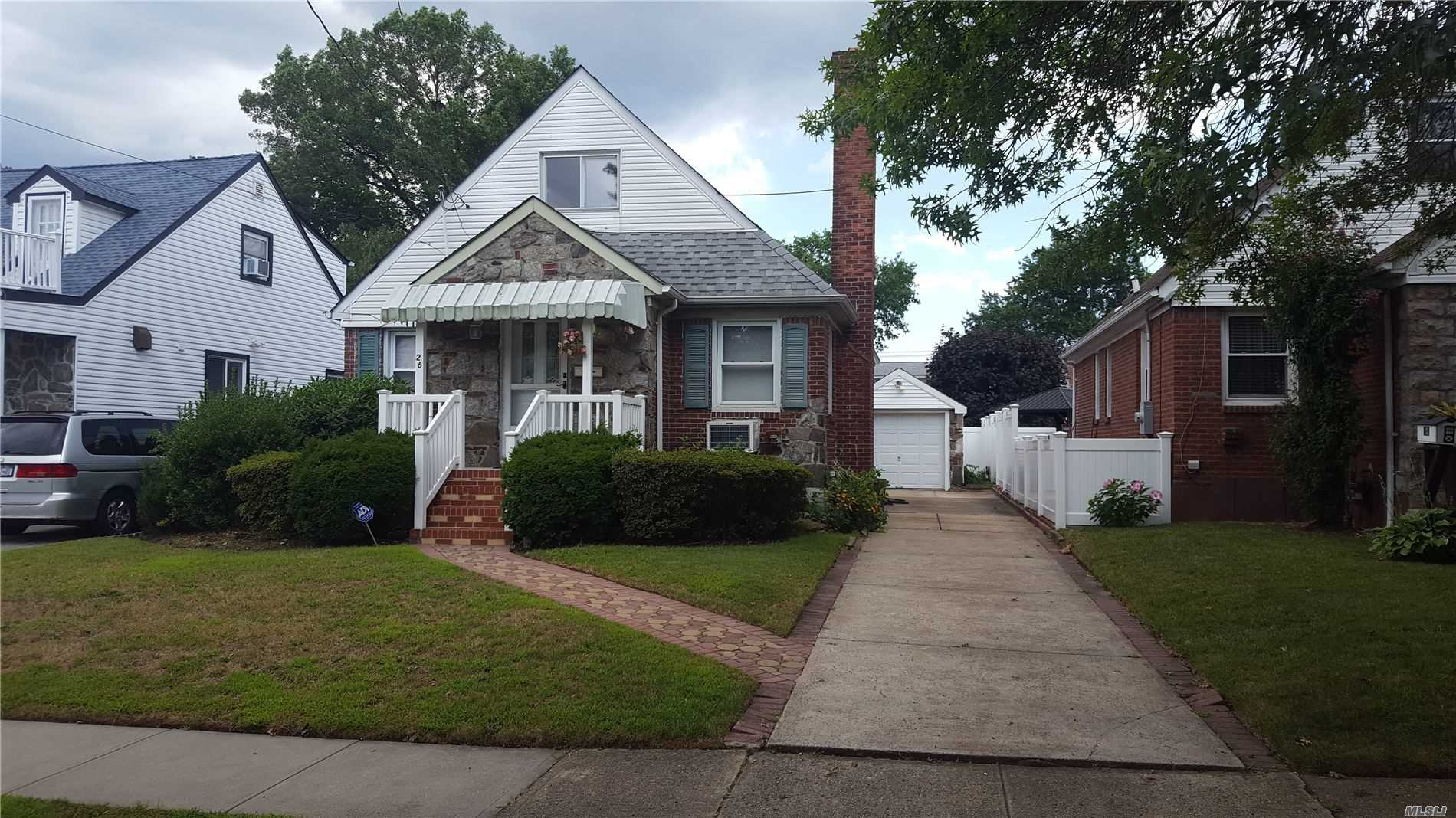 Great Home very clean, Open 1st floor layout, Lr with fireplace with granite accent wall, New windows and Roof, and cement work. close to schools and shopping Elmont schools, Full Taxes are 8360