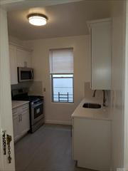 Newly renovated apartment kitchen with 4 piece stainless steel appliances,  wood fllors thoughout, front aprtmnet on third floor, room for small dinnning table, large living room .New kitchen installed now. Two large bedrooms, Large living room with extra closet, Full bath with linen closet. Bus stop on corner. Walking distance to train station, Plenty of street parking on quiet block.