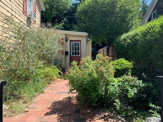 Great Village Location , Corner Office or Professional Use w a couple of Walk Up Steps. Two Separate Rooms . Walk to the Village, Jitney , 3 Miles to Stony Brook, 1 Mile to Train, Ferry a few Blocks Away. Cozy Front Courtyard to Enjoy.