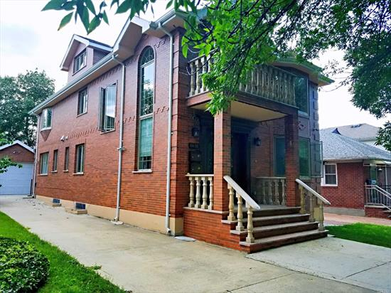 5 years young all brick 2 family. Duplex modern kit /w radiant heat floor. Cathedral ceiling, 3 brs 2 full baths, Finished huge basement w/Sep entrance with marble floor . Full bath , laundry rm. Rear 1st Fl Apt.3 brs 2 full baths w/Sep entrance. School District 26 .