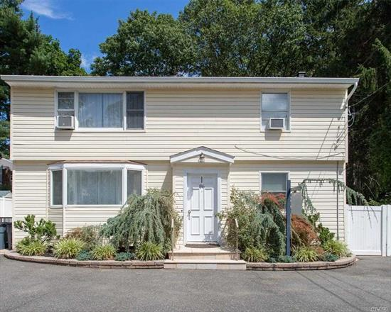 Fabulous legal two-family home in E. Northport. Upstairs has 2 bedroom apartment with large deck off kitchen. Main level has 3 bedrooms, beautiful updated kitchen and spacious finished basement with outside entrance, egress windows and tile floors. Three updated bathrooms. Fenced yard with paved patio. Not your typical rental property. Very well cared for. A rare find!