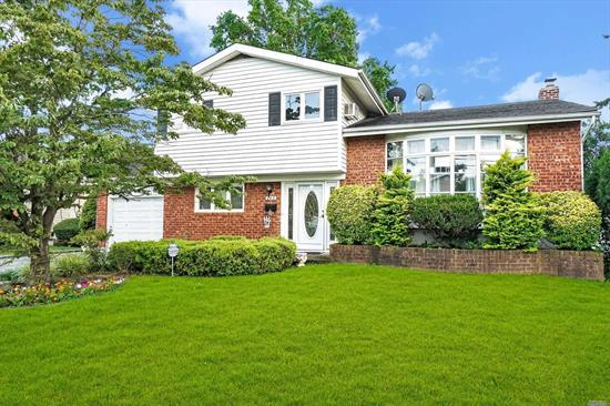 Beautiful Brick & Vinyl Sided (Large) Split Level, 4 bedrooms, 2 full baths, Bright, Open & Airy, Lr W/Vaulted Ceiling, Updated Eik W/Brkfast Counter & Sliding Doors To Deck, Fin. Family Rm Bsmnt, Newer W/W Carpeting & Hi Hats, Laundry Rm W/New W/D, Refin. H/W Flrs, Most New Windows, Newly Painted Interior, 200 Amps, low taxes