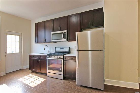 Fully Renovated Railroad Style 2 Bedroom, 1 Bath Apartment In A 4 Family House. New Kitchen And Bathroom, Stainless Steel Appliances, Wood Floors. Steps Away From Shopping And Restaurants, One Block To The Express Bus To Manhattan And Q55. Walking Distance To The M Train On Fresh Pond Road.