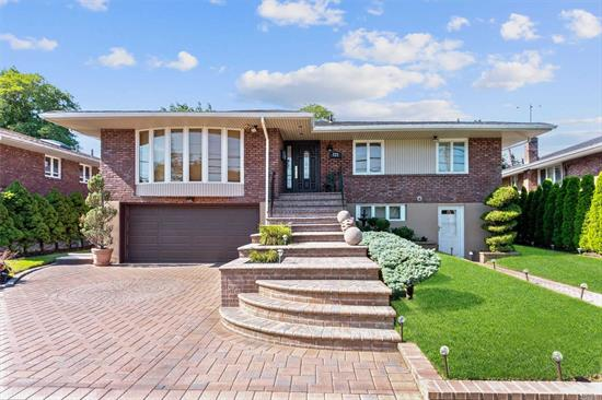 Beautiful Spacious Tropicana Hi-Ranch(3162 Sq.Ft)in Desirable North Woodmere. Home is Perfect For A Large Family and is In Move-in Ready with Extremely Low Taxes. Hardwood Floors Through Out The Home. Full Finished family room. Generous Size home with 5 Bedrooms, Bonus Rm, three updated bathrooms, Dining Room, Livingroom with Large Bay Window.A Must See Home.