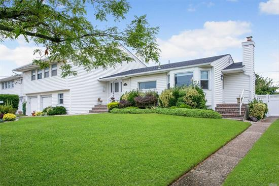 Oversized Split Level Home in Beautiful Condition. Living Room & Dining Room Have Open Layout. New Flooring in Den, New Carpeting in Master Bedroom. Finished Basement w/ Playroom, Bath, Bedroom. Fabulous Backyard with Inground Gunite Pool.