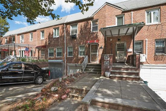 Well Maintained 3 Bdrm, 1.5 Bath Townhouse located in the Heart of Bayside! Enjoy a Full Hardwood Deck w/ Private Fenced Yard. Private Driveway, Attached Garage w/ Separate Entrance. Updated bath with Jacuzzi. High Ceilings throughout, Hardwood floors all Fully Renovated. Partially finished basement with high-hats. Close to great public & private schools, shopping, various places of worship, transportation to NYC, LIRR, Q27, Q30, Q31. Easy Street Parking