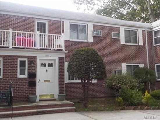 Large upper 3BR used as 2BR with dining room, Custom kitchen has 42 cabinetry and granite countertops, white tiled bath, Terrace off living room, Pull down stairs to large storage attic, Large courtyard close to all.