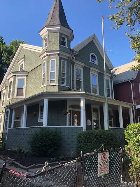 Turn of the Century Victorian Home with hardwood floors, new windows, unique layout and tons of original details. So much space for family. Huge 50 x 100 Lot with 2 car garage.