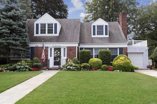 Side Hall Expanded Cape with lots of room for entertaining.First Floor has Formal Living rm with wood burning fireplace, Updated Kitchen with Granite&Stainless Appliances.Formal Dining Rm, Family rm with Built in wall Unit & Skylight. Two Bedroom & New Full Bath The Second floor has Two Spacious Bedrooms , Full Bath , large Hall Cedar Closet .Basement has Spacious Finished Area laundry , Utilities & Storage. Attached Garage. Beautiful Backyard & Paved Patio to Enjoy.