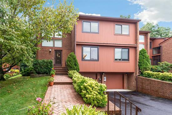 Totally up dated Cricket Club corner townhouse. Spacious Open floor plan. Living room with Fp, Formal Dining room, large kitchen with dinette, pantry and laundry area,  2 Bedroom plus bonus sitting area. 2.5 bath, Lovely deck and yard, . CAC, hardwood floors,  basement and attached 2 car garage. Community with pool and tennis. Near by playground. Shuttle to Manhasset train station from Village of N. Hills, (1 block),  Herricks schools,  Great location, easy access to highways.