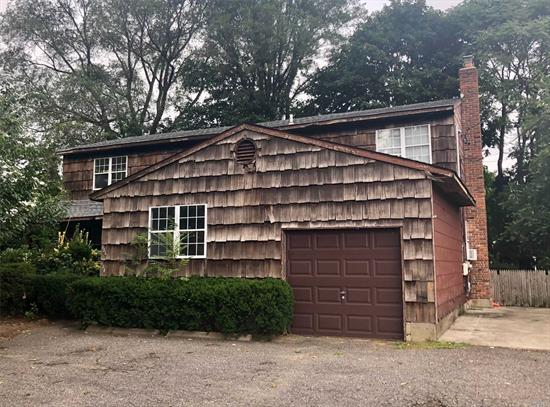 Legal Two Family House. Perfect Location For Professional Office With Proper Permits. Great Investment Potential. Plainview-Old Bethpage Schools.