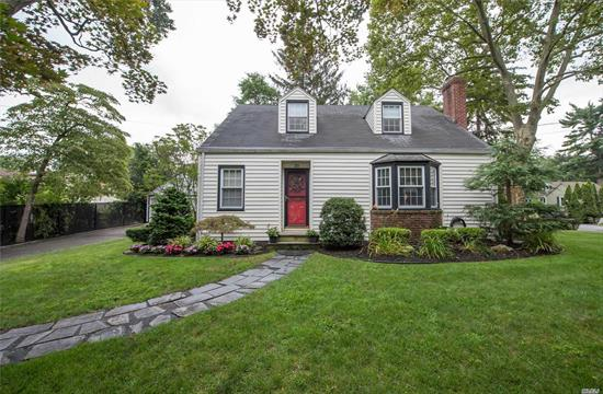 Charming, Very Well Maintained Cape Cod Colonial on Picturesque .23 Acre. Formal Liv Rm w/ WB Fireplace. Formal Dining Room. Updated Main Floor Bathroom. Hardwood Flooring. Hi-E Furnace. Enclosed Porch. Large, Brick Patio. Detached, 2 Car Garage. 150 Amp Electric. Truly a Gem!