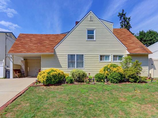 Perfectly maintained Rear Dormered Expanded Ranch in The Heart of Levittown. Home features 4 Bedrooms 2 Baths, Living Room with Fireplace. Large Yard with Patio great for entertaining.Beautifully Manicured Landscaping. Make this your dream home.