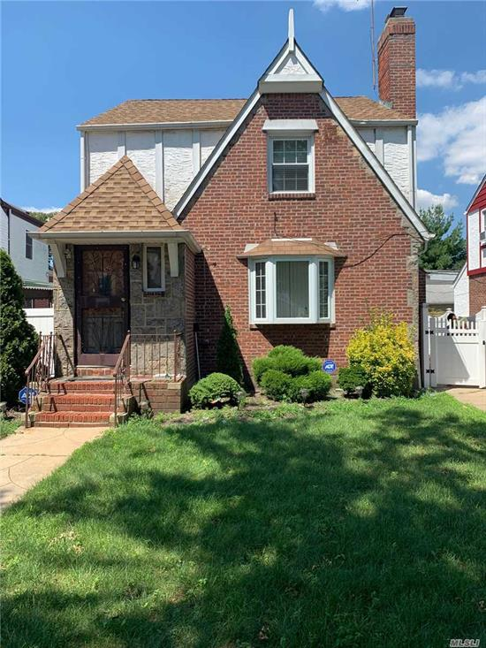 Property has hard wood floors, working fire place, back patio & a walk up attic. Basement has 1 bedroom apartment with separate entrance with full bath and stand up shower.
