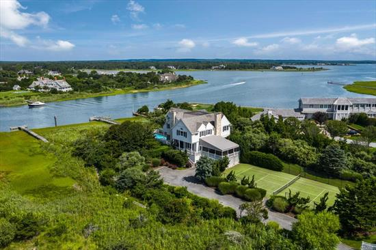 Waterfront living in the Hamptons doesn't get any better than this on 1.4 acres with over 160 feet of bay frontage, complete with a deep-water dock, all-weather tennis court, bayside heated gunite pool, and a deeded walkway across Dune Road to the ocean. The immaculate home's interior was designed by Rick Livingston of Period Design and boasts panoramic sunset views over the Quogue Canal to the Quogue Field Club, Penniman Creek and Shinnecock Bay.