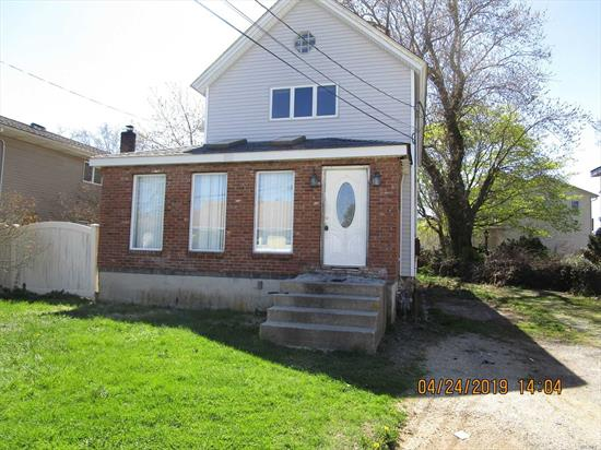 Bring this nice size colonial back to life. With some work this could once again become the pride of the neighborhood. Walk to shopping, schools and just minutes to great Baldwin park and Baldwin's Long Island Rail Road station.  Property is over 125 feet deep and has plenty of room for a pool or just great gatherings.