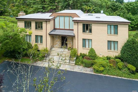 Magnificently Designed by a Famous Architect, Elegantly Appointed C/H Colonial On 1 Acre. Boasts Large Entry Foyer Leading To Gracious Lr W/Fplce, Frml Dr , Den, Eat In Kitchen, Maid's Rm+Bath And Laundry/mudroom. Huge Master Bedroom Suite With Sauna, Marble Bath and Walk-in closets. 3 Add. Bdrms And 2 Bathrooms Adorn The 2nd Floor. Full Finished Basement With Sitting Area and Cedar Closet. Great For Entertaining and Family Living.