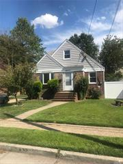 Newly Renovated!!! Lovely, Large Cape cod Home, New Paint, Polished Floors, High Ceilings, New Kitchen & Bathrooms. Enclosed Porch in the rear, Full finished Basement Included!! Access to Yard & Private Driveway.. Won't Last, Inquire Accordingly!