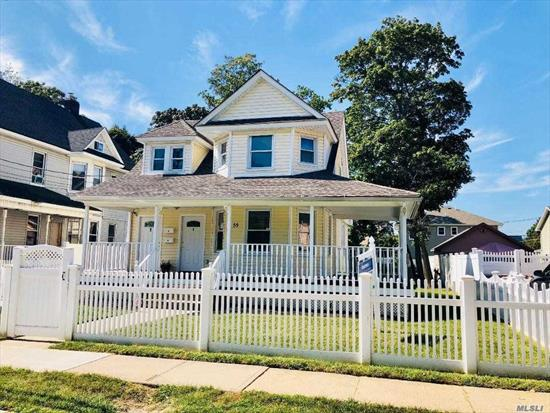 Beautifully Updated Legal 2 Family with Additional Room for Mom! Quiet Residential Neighborhood just 5 Blocks to LIRR. 2 Updated Kitchens, 3 Updated Baths, 2 Updated Gas Burners, Updated Roof and Siding, Wrap Around Porch, Large Private Yard... Just unpack and Start Collecting Rent!!
