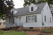 Charming Cape Cod requiring TLC that is 0.2 miles from the Malverne train station and heart of town. This lovely home features a L/R with Fireplace, D/R, Kitchen, 2 BDR's, 1 Full Bath and Harwood floors throughout. The Unfinished, full sized-walk up attic provides ample space for potential additional bedrooms. House being sold As-is. Malverne schools.