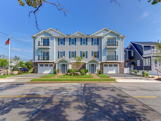 New Custom Home Offers 3 Br, 2.5 baths, Light Drenched Oversized Lr, Designer Eik, Formal Dining Room, 2 Car garage. Enjoy Oceanviews on your private balcony in both Master Br and Lr and Beautiful landscaped private yard