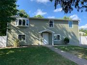 Fully Renovated and Re-Designed Home with New Deck, New Kitchen, Baths, and Lots of Potential.....Close to Sunrise Hwy....