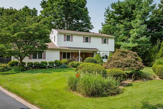 Pride of ownership in this updated 5 bedroom, 2.5 bath colonial. Anderson windows & vinyl siding, roof 7 years old (1 layer), CAC 3 years old, 2 newer baths, Updated kitchen with solid maple cabinets, hot water heater 5 years old. Cesspool less than 10 years old. Country-club backyard with composite deck and 20x40 IGP. Beautifully landscaped. 2 car garage, laundry on first floor, leaf guards on back gutters. Close proximity to highways. Elwood S.D.