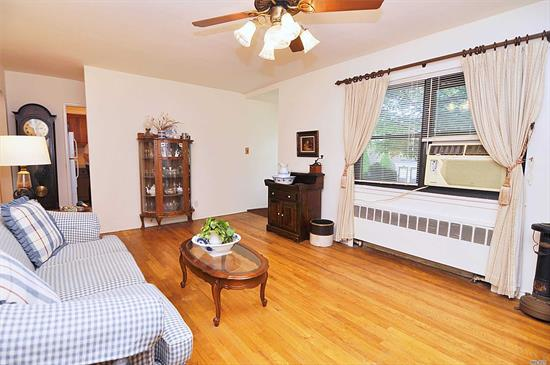 Newly Listed! Lower Unit, Set Inside A Beautiful Private Courtyard, Hardwood Floor Throughout, Brand New Storm And Front Doors/Windows.Private Entrance, Bbq Ok, Parking Inc, Sd26. Qm5, Qm8, Q88, Q27, Lirr, Near Parks, Shops, School, Restaurants, Security, Pet Friendly, Rent Ok, No Flip Tax, Maintenance Includes Re Tax, Heat, Gas, Parking Spaces, Landscaping, Garbage/Snow Removal, Washer Included, Storage Available, 5 Laundry On Premise, 100% Equity Coop, Maintenance Tax Deductible, Lots Of Closets,