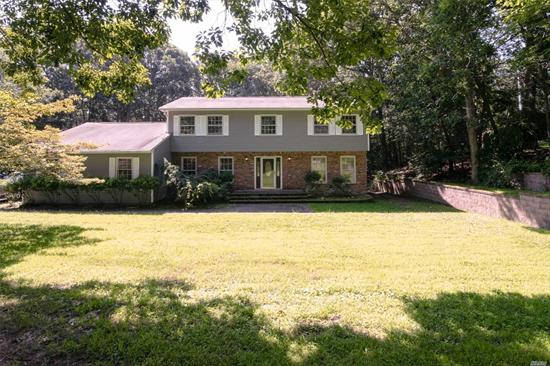 Location, location, location.This diamond in the rough 5 bedroom Colonial is located in the heart of Fort Salonga on over an acre of property on a very private & wooded setting.Peace & tranquility best describes this location.Home is in need of updates but is priced accordingly & features hardwood floors, large spacious rooms, Den with fireplace w/wood burning stove. Close to Callahan's Beach, Kayak down the Nissequgue River, Golfing, Village shops & Award Winning Kings Park SD.
