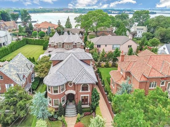 Affluent 2008 Center Hall Colonial in the Elite & Exclusive Enclave of Malba. Custom Built w/the Finest Architectural Details & Exquisite Craftsmanship Beyond Compare. Over 5, 600 sq ft of Lavish, Well-Appointed Living Space. Grand 2-Story Entry Foyer w/Sweeping Bridal Staircase & Dome Ceiling. Master Ensuite w/Balcony, WIC, MBw/Jacuz. 3Fireplaces.10 Ft Ceilings. Hardwood & Radiant Heat Flooring, Central Air & Vac. Full Finsh 2, 800+sf Bsmt I/E Windows. 2CarG Gym.Highlight Sheet & FP's for Details.