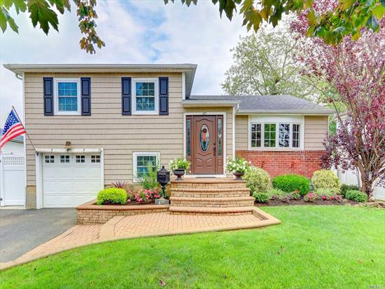 Beautiful home featuring updated kit w/granite counter tops, ss appliances, new .5 bath, beautiful wood floors, cac, gas heating system, Igs, Beautiful yard with Inground pool. Entertainers Delight!! Massapequa Schools/East Lake Elementary. LOW TAXES!!!
