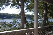 Immaculate fully furnished WATERFRONT 1 BR apartment with expansive private deck overlooking Conscience Bay and steps to private beach. Fully furnished, includes utilities, HW flrs, private partking, close to all yet a world away!