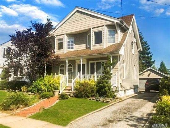THIS UNIQUE COLONIAL FEATURES A MASTER SUITE, 2 ADDITIONAL BEDROOMS, 2 FULL BATHS, HARDWOOD FLOORS, GRANITE COUNTER TOPS, LIVING ROOM W/ WOOD BURNING FIREPLACE, CAC, LARGE FORMAL DINING ROOM, 2 CAR GARAGE, AND FULL FINISHED BASEMENT! LOCATED ON THE LYNBROOK BORDER! GREAT LOCATION, CLOSE TO LIRR AND TRANSPORTATION! A MUST SEE! WONT LAST!