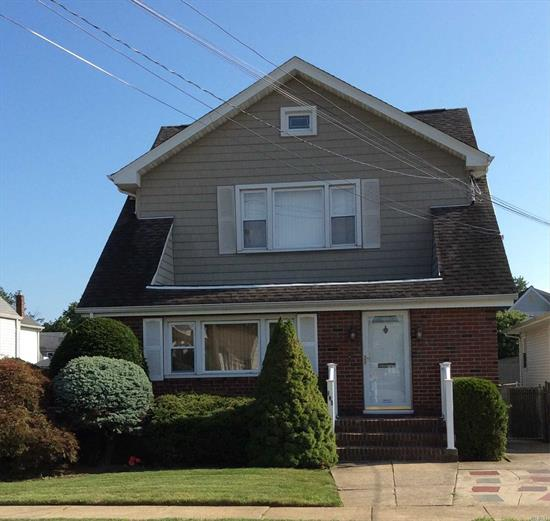 Impeccably maintained 2 story home. Close to LIRR and you can be in NYC in 30 minutes. Professionally landscaped and maintained, fully fenced property. Home was taken down to studs and rebuilt inside and out less than 10 years ago. Office on first floor can be used as a bedroom and closet system in 3rd bedroom can be removed upon request. Master Bedroom has custom made private vanity area. Ample private parking. House alarm system. Taxes to be verified by buyer