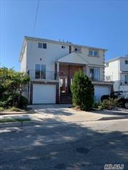 Very spacious home in excellent condition. Eat in kitchen which goes out to a deck overlooling the bay.  Large formal dining room and Living room, 2 1/2 baths with a 1/2 bath on main floor, 3 bedrooms, master bedroom has private bath attached garage. Must See !