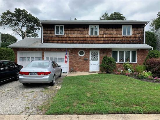 Spacious 4 BR, 2.5 Bath Splanch In Prime Mid Block Location. Updated Heating System, Park like Property. IG Gunite Pool As Is