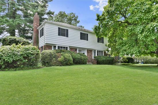 Classic Munsey Park Colonial located in one of the most prestigious zip codes on the North Shore of Long Island. This home features a grand 2-story Foyer, lacquered hardwood floors, soft warm interior tones and generous living areas. There are 5 Bedrooms, 4 Baths and a 2nd wing on the 1st floor. This rare corner lot features mature trees and landscaping on a picturesque gorgeous block. Close proximity to the Americana Shopping Mall, Dining and LIRR. Manhasset Schools!